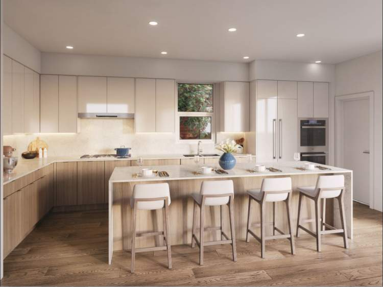 Large kitchen island, square eased-edge polished quartz countertops, premium KitchenAid appliance package.