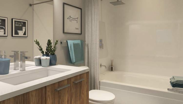 Quality laminate countertops, Moen plumbing fixtures, white acrylic tub & shower inserts, and dual-flush toilets.