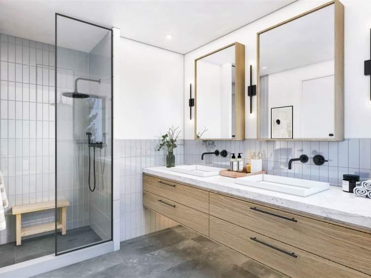 Beautiful bathrooms include dark slate natural stone flooring, sleek granite countertops and glossy textured tile.