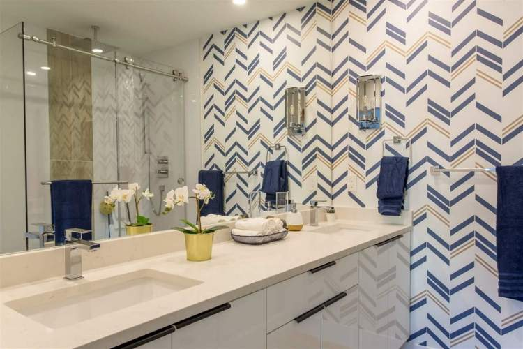 full glass shower, contemporary cabinetry, and porcelain tile flooring.