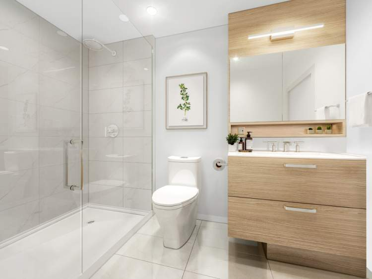 En suites are both luxurious and practical with Kohler fixtures and a mirrored medicine cabinet.