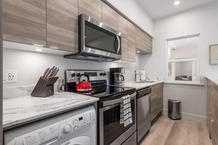 Each suite is finished with vinyl plank flooring, quartz counters, and stainless steel appliances.