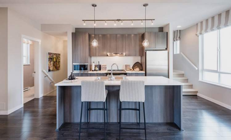 Gourmet kitchens with stainless steel appliances and soft-close hardware on drawers and cupboards.