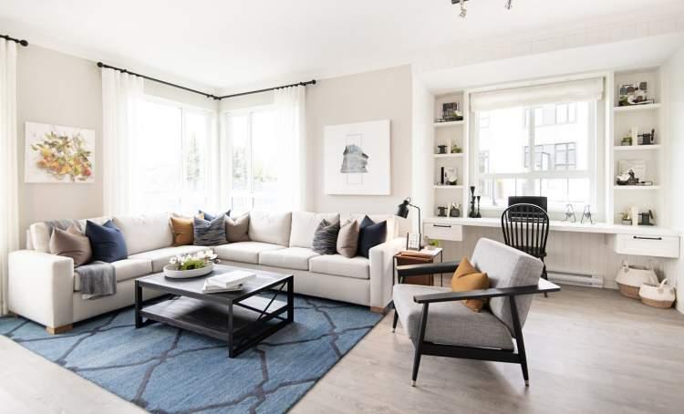 Rich laminate flooring runs throughout the main living areas.