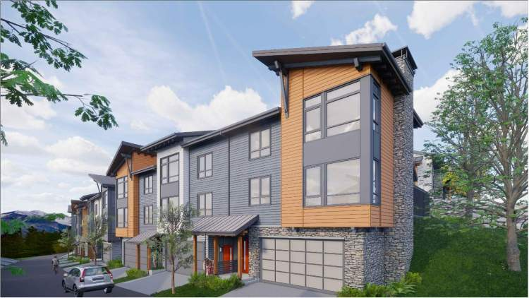 Three-storey buildings containing two to five 2-bedroom townhomes.