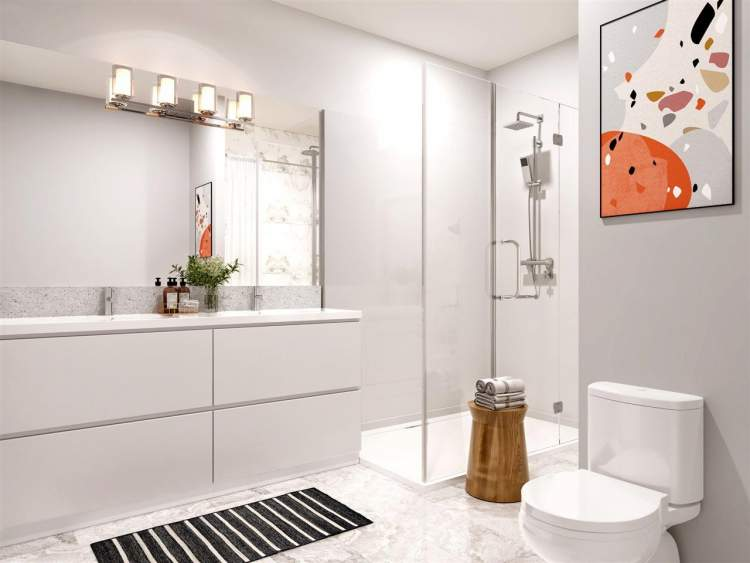 Adaptable bathrooms with deep soaker tub and large walk-in shower.