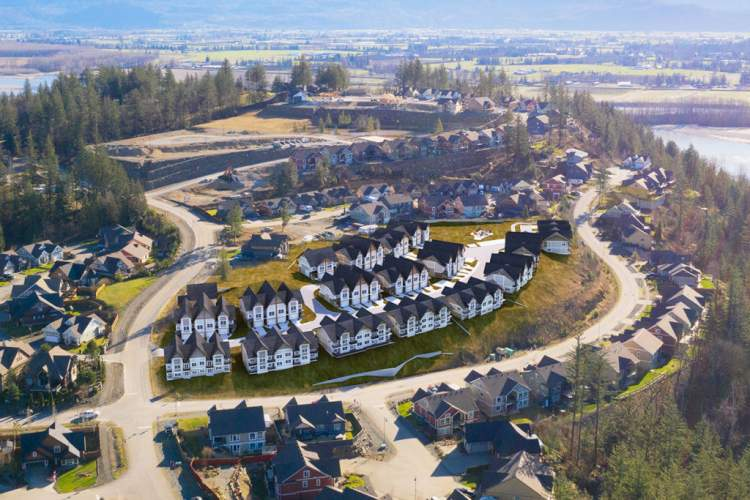 A master-planned community of 65 townhouses and detached homes.