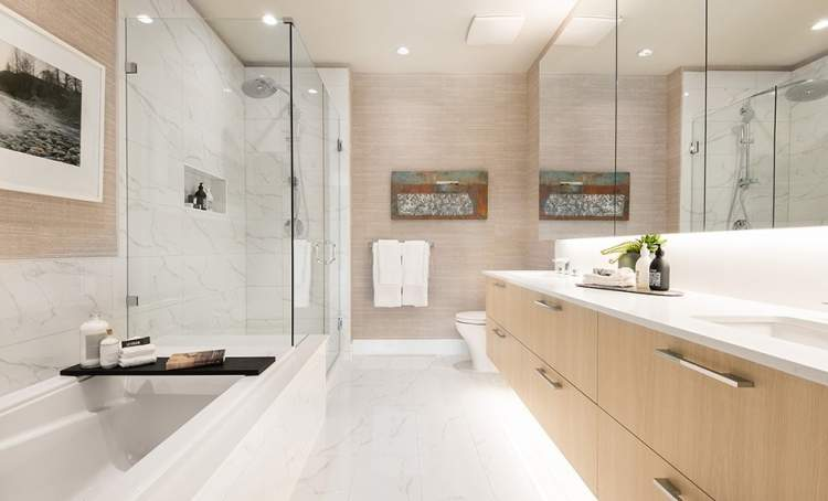 Retreat to the luxurious en suite featuring a spa shower with frameless glass door.