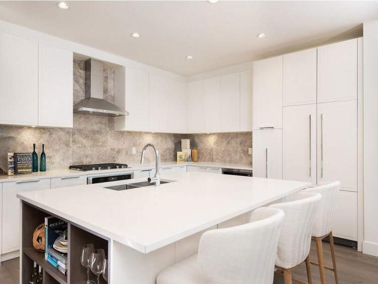 A gourmet kitchen with plentiful counter space and stainless steel appliances.
