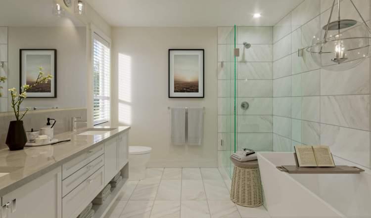 Spa-inspired finishings, including porcelain tile flooring, quartz countertops, and porcelain undermount sinks.
