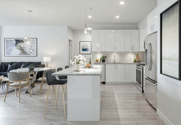 Open-concept floorplans feature laminate flooring, stainless steel appliances, and granite countertops.