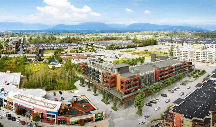An urban complex of ground-level commercial space and market residential units above.