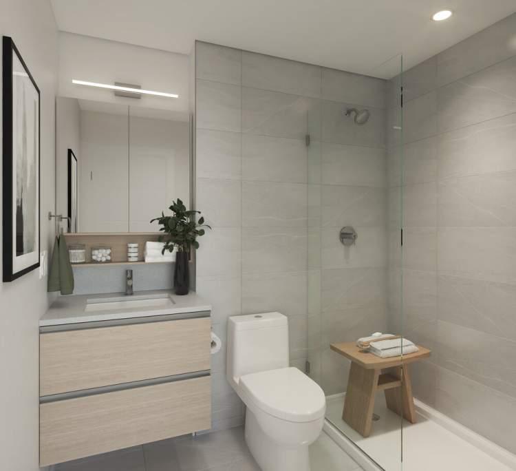 Custom-designed bathroom, with laminate cabinets and quartz countertop.