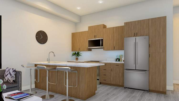 Kitchens feature flat panel cabinetry, quartz countertops, and a stainless steel appliance package.