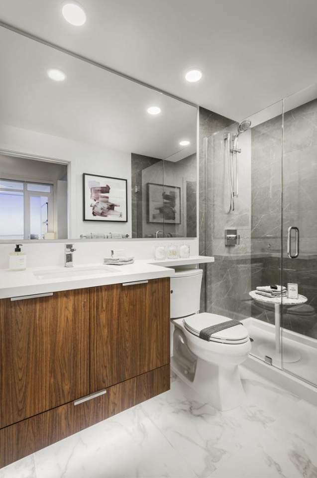 Modern, frameless-glass and tile shower with premium Kohler fixtures.