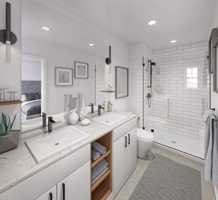 Luxurious quartz dual-sink vanity in all master en suites.