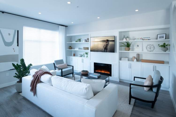 A signature entertainment centre with custom millwork and sleek electric fireplace is in most homes.