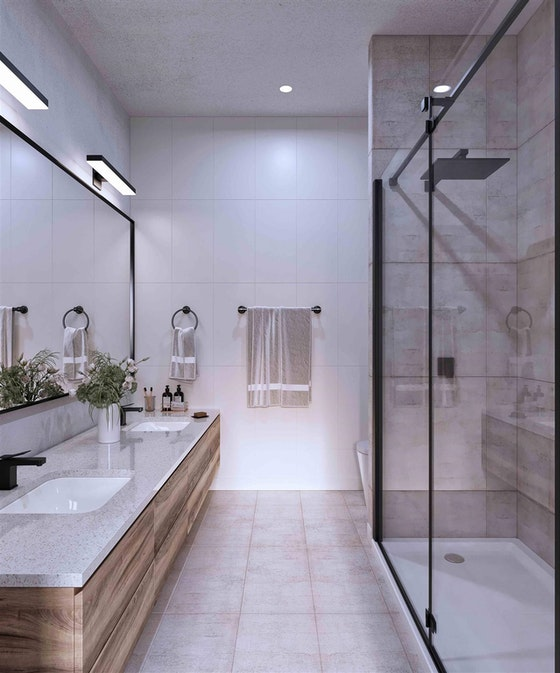 Elegant en suites with framed vanity mirrors, his & hers undermount sinks, and quartz countertops.
