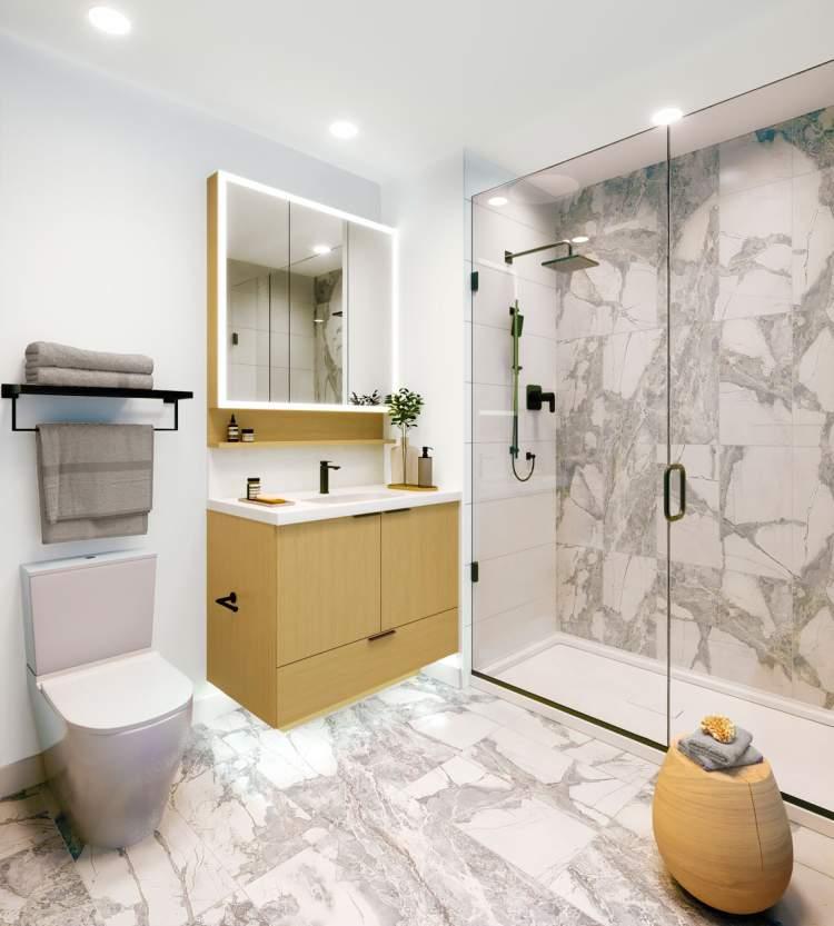 Contemporary baths with frameless glass shower enclosures.